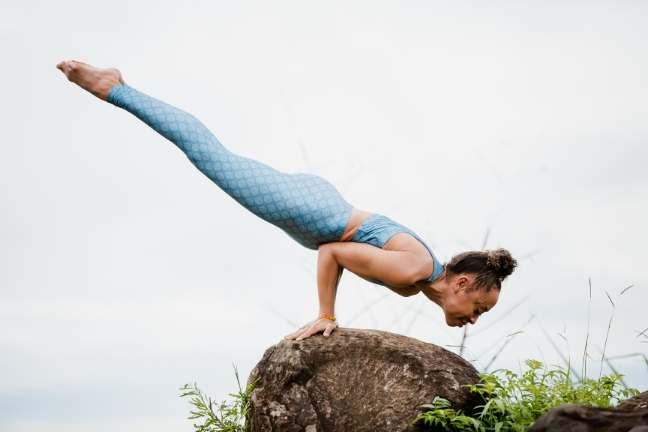 laruga glaser in mayurasana ashtanga yoga posture